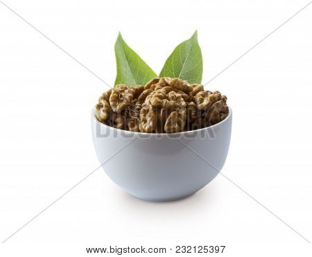 Kernels Walnuts With Leaves Isolated On White. Walnuts In A Bowl Isolated On White Background. Walnu