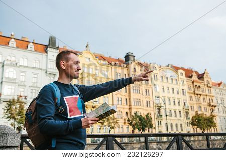 A Tourist With A Backpack On The Backdrop Of The Old Architecture In Prague In The Czech Republic. H