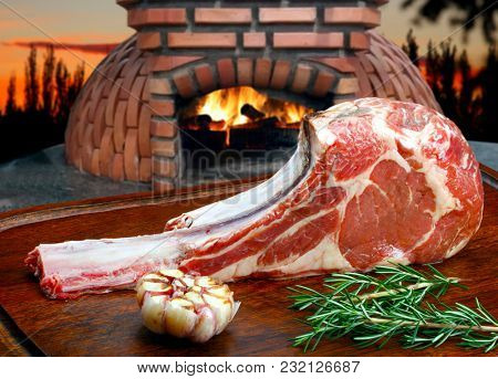 beautifully seared tomahawk steak, medium rare to rare