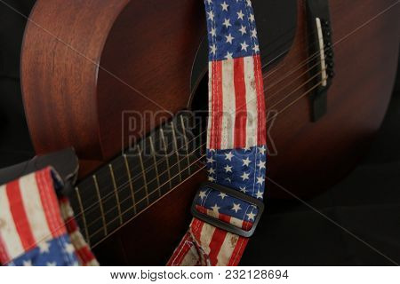 Acoustic Guitar On Side With American Flag Strap