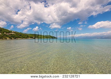 Crystal Sea Water, Summer Scenic View Of Apras Bay Near Kassiopi On Corfu Island In Greece.