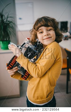 Happy Little Kid Embracing With Diy Robot