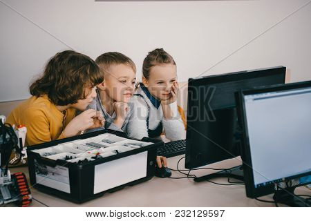Focused Kids Working With Computer Together, Stem Education Concept
