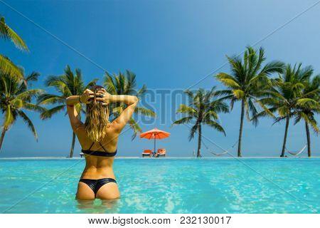 woman in luxury five stars  spa resort in the swimming pool.