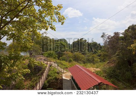 A Popular Sri Lankan Picnic Site At Sorabora Lake In The Central District With A Footbridge And Trop