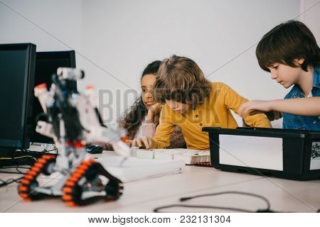 Focused Little Kids Constructing Diy Robots, Stem Education Concept