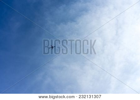 Airplane On Blue Sky Low Angle View