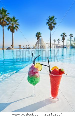 Tropical cocktails in resort infinity pool lounge bar