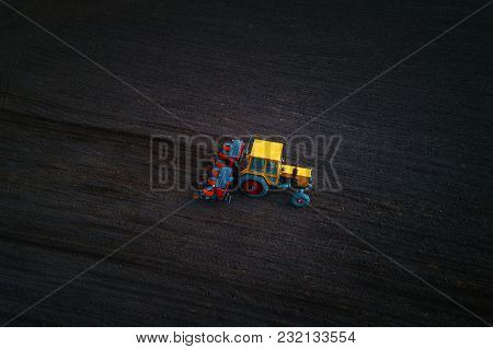 Aerial View Of Tractor Working On The Harvest Field