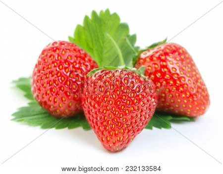 Heap Of Ripe Strawberry With Green Leaves Isolated On White Background