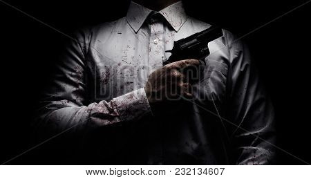 Horror Scary Photo Of A Killer In White Shirt With Blood Splatter And Posing With Black Gun On Dark