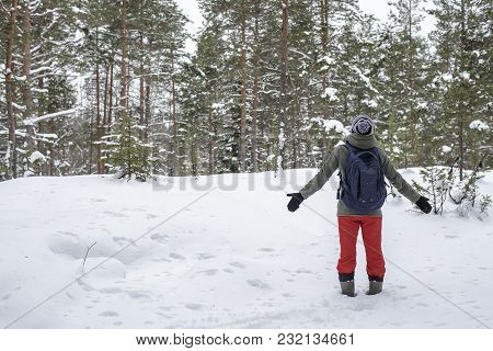 Woman Stands Having Stretched Hands In The Parties And Admiring The Winter, The Snow-covered Forest.