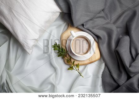Coffee With Winter Home Background, Cup Of Hot Coffee Marshmallow, Warm Knitted Scarf On Grey Bed Ba