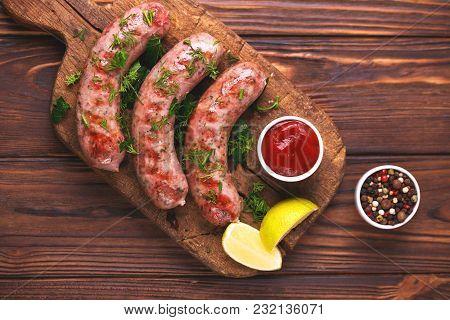 Grilled Sausages With Lime On Iron Grill Pan