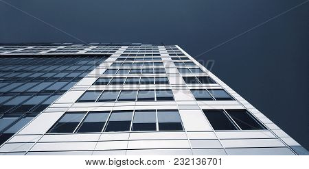 Low Angle Abstract Perspective View Of Modern Commercial Office Building With Lot Of Windows Against