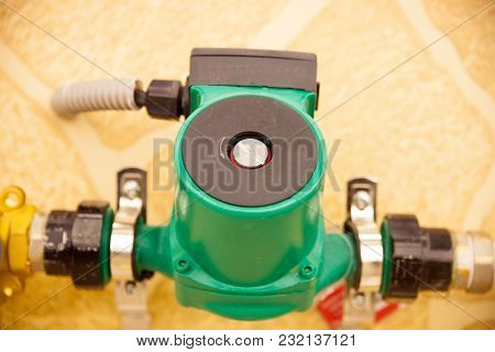 Circulation Pumps On Theof Pipes Of A Warm Floor Under A Laminate Of A Parquet And A Tile Floor Heat