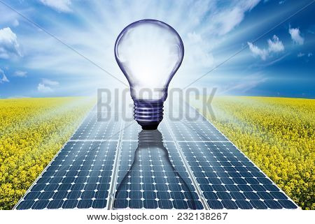 Conceptual Illustration With Blue Sky And Rays Of Sunshine Illuminating Solar Panels