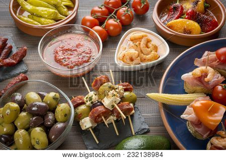 Mixed Spanish Tapas Starters On Table. Open Sandwiches, Shrimps, Olives, Grilled Pepper, Pickled Veg