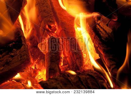 Scorched Wood And Glowing Coal In The Fire