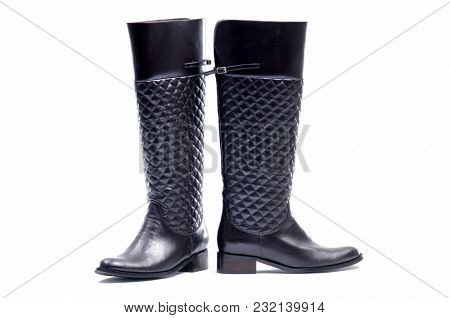 The Pair of Black Vintage Women knee-high leathers boots isolated on white background.