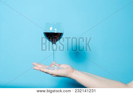 A Glass Of Wine In A Woman's Hand. Alcohol Party.