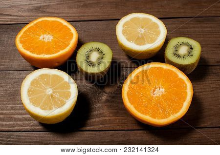 Citrus On A Wooden Background. Healthy Eating. Concept Of Diet
