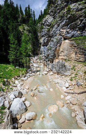 View of a mountain river in Dolomites, Fiames, Cortina dâ??Ampezzo