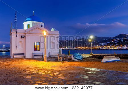 Traditional Small White Church On The Waterfront In The City Of Chora At Dawn. Island Mykonos. Greec