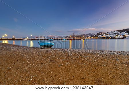 City Embankment And Fishing Boat On The Beach At Dawn. Mykonos. Greece. Chora.