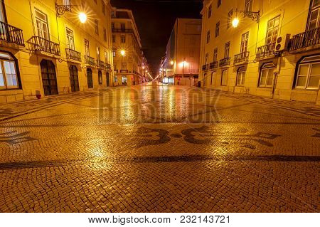 Typical Stone Colorful Mosaic On The Pavement In Lisbon At Night. Portugal.