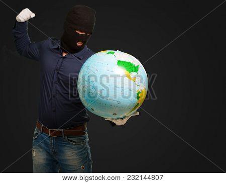 Burglar Man Punching Globe On Black Background