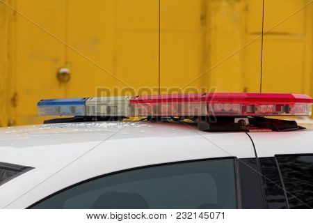 Flasher On The Roof Of A Police Car
