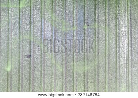 Wall Of Sheet Metal. Beautiful Blank Background With Colored Green Overflows. Texture Of Corrugated