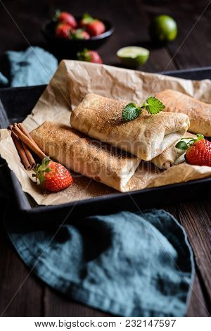 Sweet Baked Chimichangas With Strawberry Filling