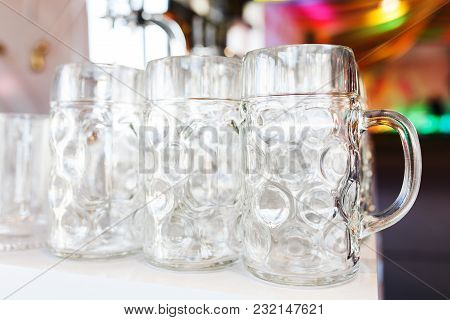 Empty Beer Glasses Prepared By The Barman For The Guests And Participants Of The Big Party. Beer Fes