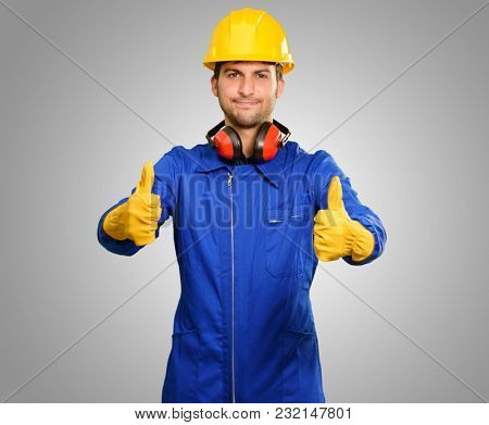 Engineer With Thumb Up Sign Isolated On Grey Background