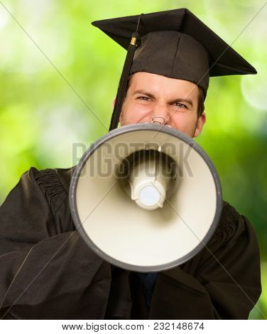 Graduate Man Shouting Into The Megaphone, Outdoors