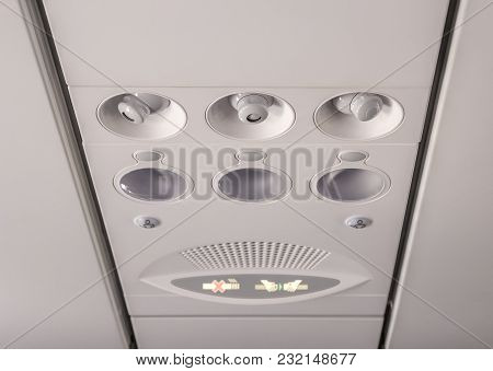 Adjustable Lights And Air Conditioners Overhead Seat Controls Of A Commercial Aircraft In An Airplan