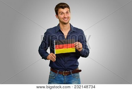 young man holding germany flag
