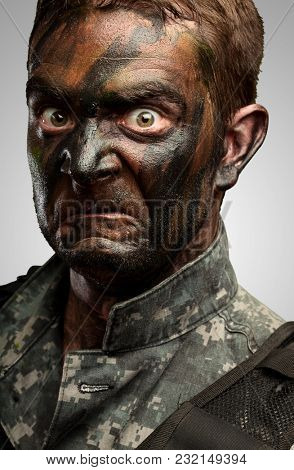 Close Up Of Angry Soldier Face against a grey background