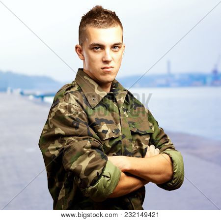 Portrait Of Angry Soldier at a port