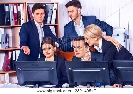 Business people office life of team people working with papers sitting table. Cabinets with folders and jalousie background. Modern methods of doing business. Corporate strategy.