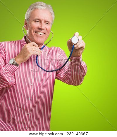 Portrait Of Happy Doctor against a green background
