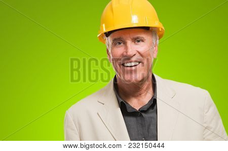 Male Architect Smiling against a green background