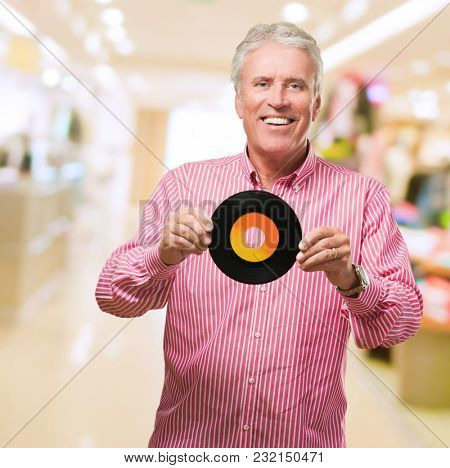 Happy Man Holding Old Vinyl at a mall