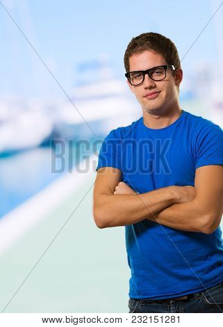 Handsome young man wearing eyeglasses at a port