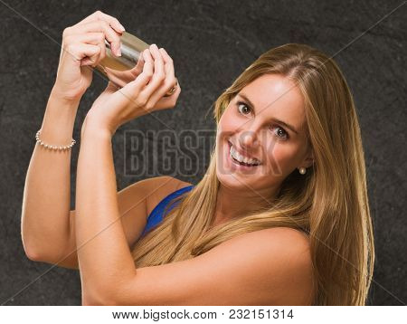 Woman Holding Shaker against a grunge background