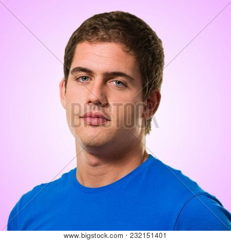 Handsome young man against a pink background