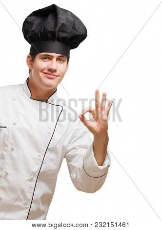Portrait Of A Young Chef Gesturing On White Background