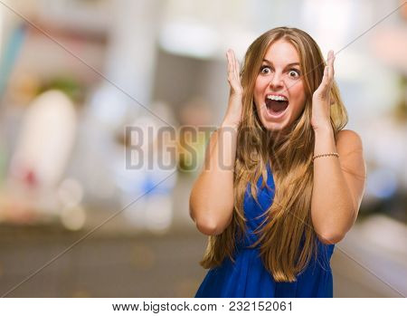 Portrait Of An Angry Woman Yelling against an abstract background